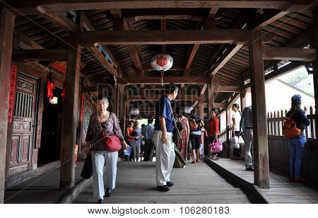 Tourists Visiting The Japanese Bridge In Hoi An City, Vietnam
