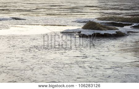 Icy Rock In River