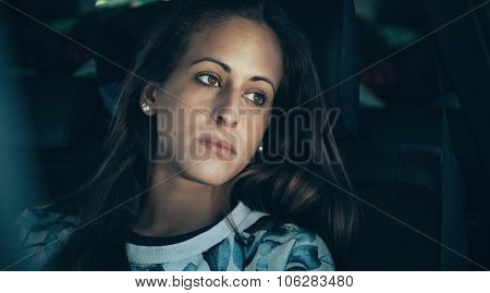 Sad young woman girl crying sitting inside of car