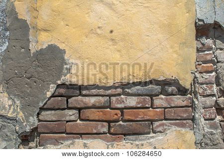 old chipped plaster on the brick wall texture background