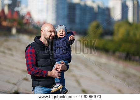 Father And Son Walking In Fall