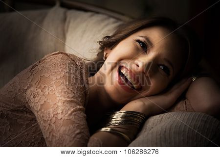 rich young woman smiling wearing expensive luxurious golden ring. Studio