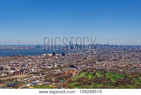 Aerial View Of Brooklyn With Manhattan Skyscrapers In The Background