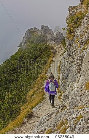 Mountaineering Young Woman, Foggy Alpine Landscape