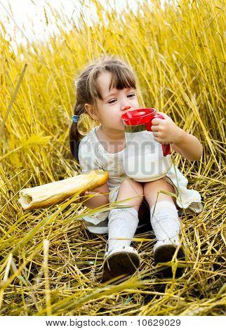 Girl Eating A Long Loaf