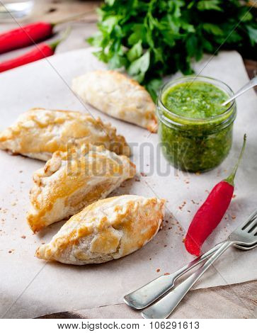 Empanadas with meat and green chili sauce. Traditional mexican dish.