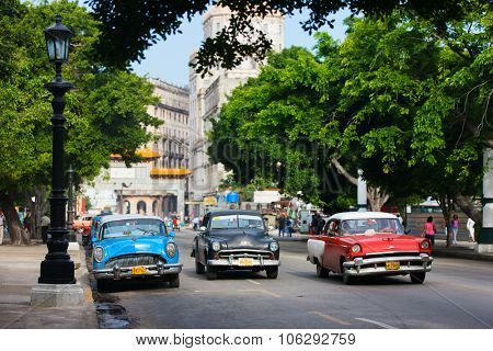 HAVANA, CUBA - JULY 17, 2013: Old classic retro Chevrolet cars on the street of Old Havana, Havana, Cuba. This is the most common mode of transportation for locals and tourists and are used as taxis.