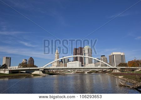 Columbus Ohio along the Scioto river with the Main Street Bridge in the foreground.