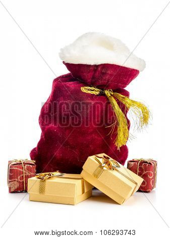 Santa Claus bag full of christmas presents over white background
