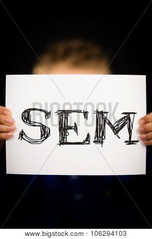 Male Holding Sem Sign