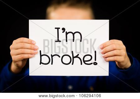 Person Holding I Am Broke Sign