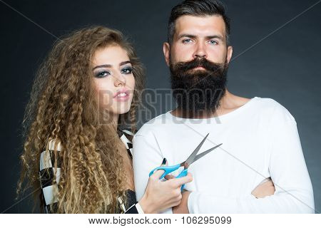 Portrait Of Couple With Scissors