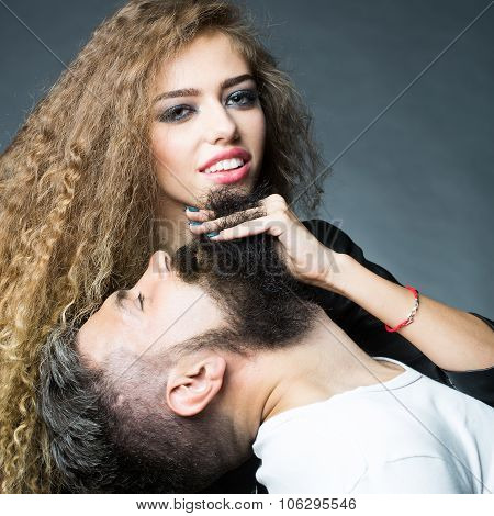 Woman Running Fingers Through Beard