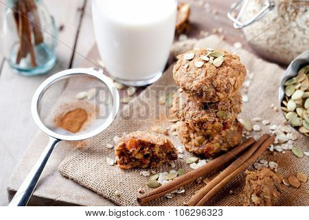 Oat and peanut butter cookies with pumpkin seeds,cinnamon,milk.