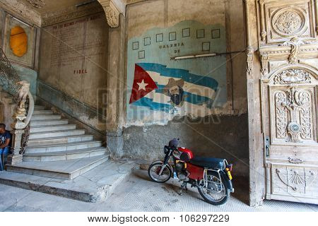 HAVANA, CUBA - JULY 16, 2013: Painting of Fidel Castro on a grunge old wall in Old Havana, Cuba.