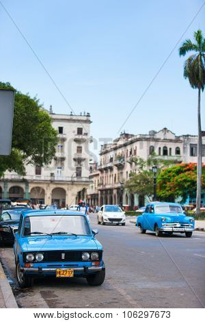 HAVANA, CUBA - JULY 16, 2013: Old vintage, classic retro cars on the street of Old Havana, Havana, Cuba. This is the most common mode of transportation for locals and tourists and are used as taxis.