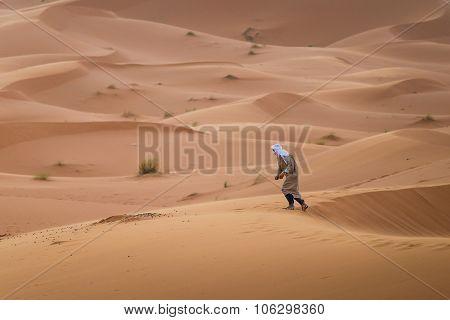 Touareg Walking In The Desert