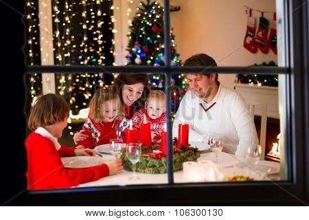Family At Christmas Dinner At Home