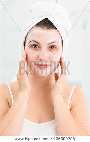 Spa Female Applying Face Mask