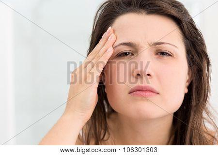 Girl Examining Her Face Skin