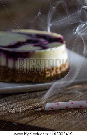 Huckleberry Cheesecake With A Candle
