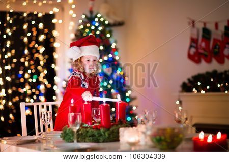 Child At Family Christmas Dinner At Home