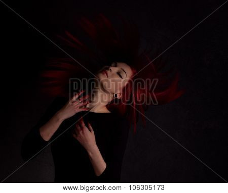 Dark Portrait Of A Beautiful Girl With Developing Long Red Hair And Fingers In Blood