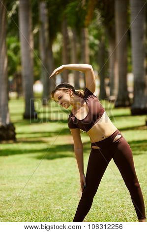 Woman Doing Stretching Before Sport Training At Morning-4