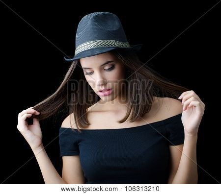 Portrait Of Beautiful Brunette Girl In Black Hat And Black Sweater Isolated On Black Background