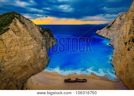 Dramatic view of beautiful Shipwreck Bay in stormy weather, Navagio Beach on Zakynthos Island in Greece.