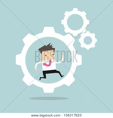 Businessman is running in the cogwheel machine