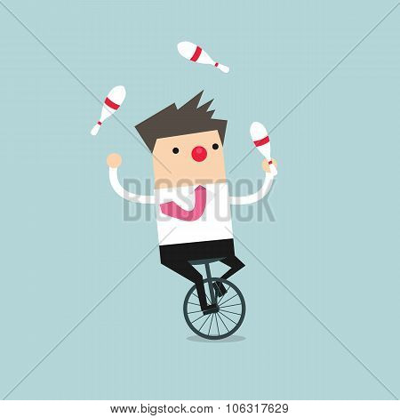 Businessman juggling while cycling with red nose