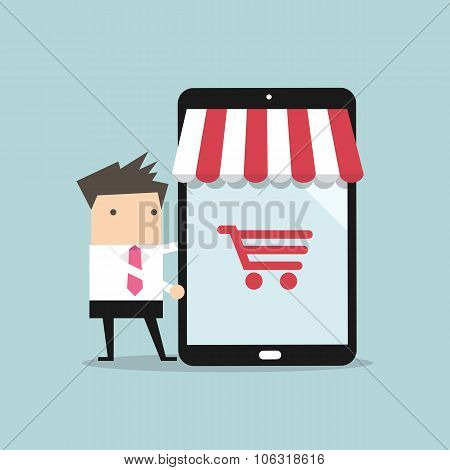 Businessman with online shop on tablet