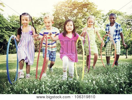 Hula Hooping Park Children Cheerful Concept