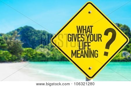 What Gives Your Life Meaning? sign with beach background