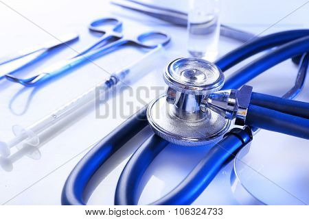 Stethoscope with medical equipment on white background, close up