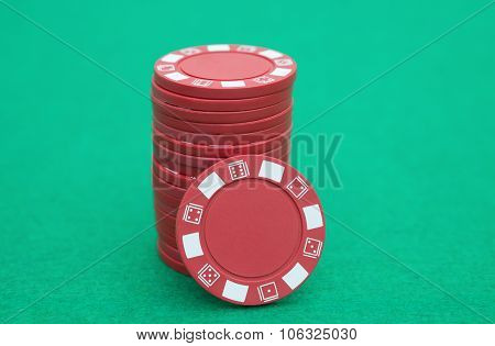 Stack Of Red Poker Chips On Casino Table