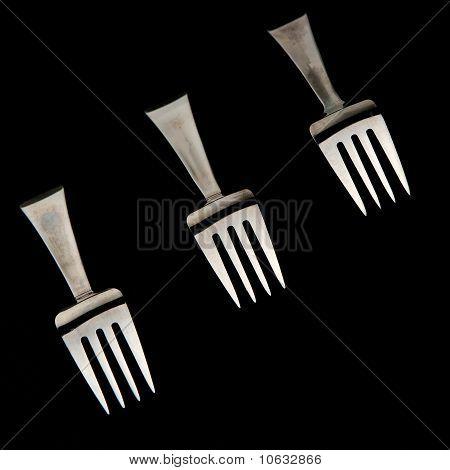 Forks Against Black Background
