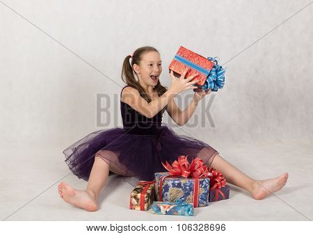 Girl Rejoices Boxes With Gifts
