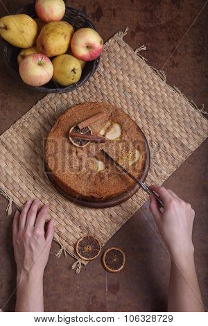 The Woman Cuts A Charlotte With Apples
