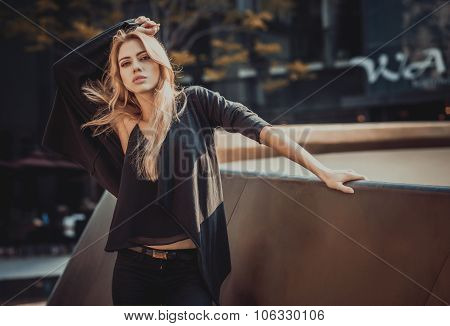 Beautiful young model woman posing in modern architecture environment.