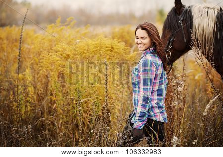 Happy woman with horse outdoors