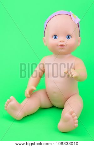 Naked Baby Doll Sitting Pose, Isolate Green Background