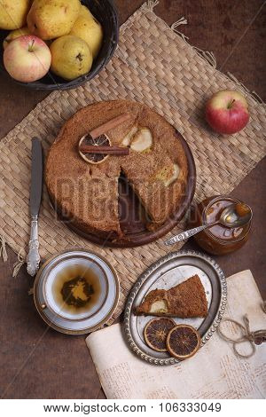 Charlotte With Apples And Cinnamon And A Cup Of Tea