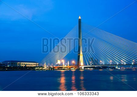 Chao Phraya River And Cable Bridge On Sunset In Bangkok, Thailand