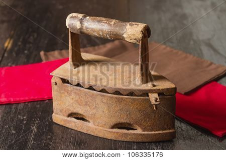 The Old Clothing Iron On A Table