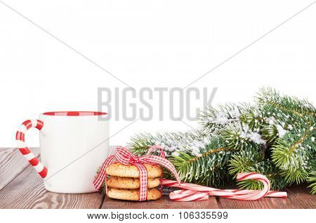 Christmas tree branch, cookies and mulled wine cup. Isolated on white background