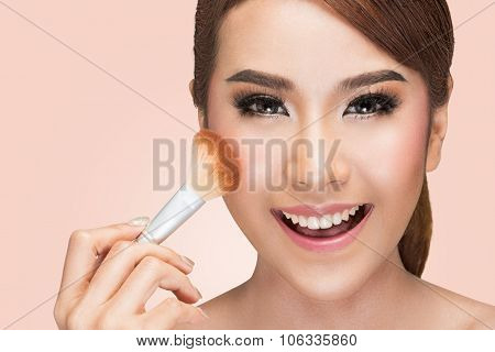 portrait asian woman using makeup brush