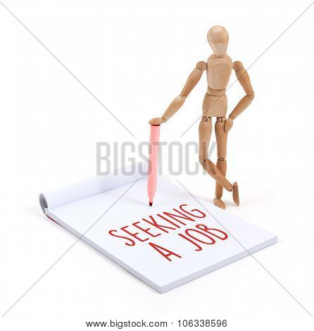 Wooden Mannequin Writing - Seeking A Job