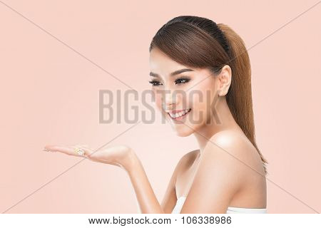 Beautiful Spa Girl showing empty copy space on the open hand palm for text